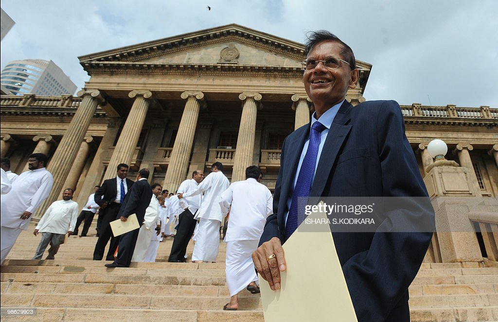 Sri Lanka's new Foreign Minister G.L Peiris poses for photographers after being sworn in in Colombo on April 23, 2010. Sri Lanka's new Cabinet was sworn in by Sri Lankan President Mahinda Rajapakse folowing his parliamentary election win on April 8. AFP PHOTO/ Ishara S