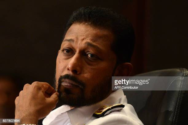 Sri Lankas new navy chief Vice Admiral Travis Sinniah speaks to reporters a day after taking office in Colombo on August 23 / AFP PHOTO / LAKRUWAN...