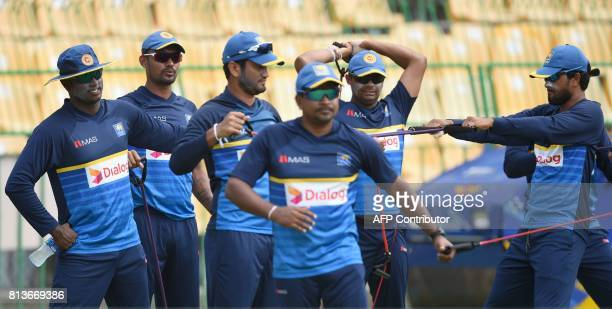 Sri Lanka's new Test cricket captain Dinesh Chandimal and teammates Angelo Mathews Danushka Gunathilaka Dimuth Karunaratne Asela Gunaratne and...