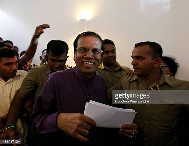 Sri Lanka's newly elected President Maithripala Sirisena leaves the opposition leader's office on January 9 2015 in Colombo Sri Lanka Maithripala...