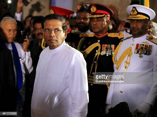 Sri Lanka's newly elected president Maithripala Sirisena prepares to take oath as he is sworn in at Independence Square in Colombo on January 9 2015...