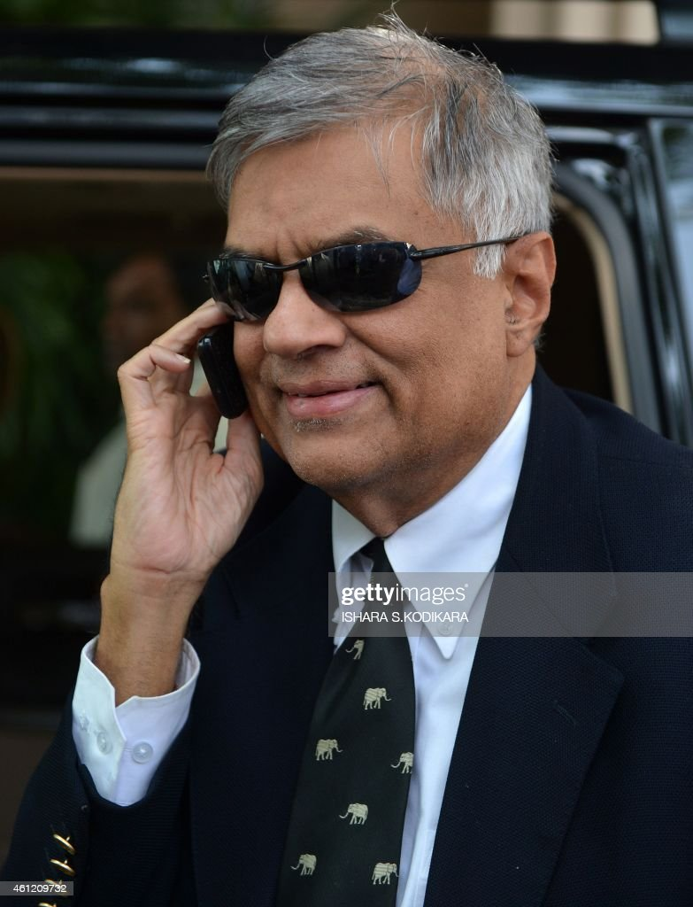 Sri Lanka's newly elected Prime Minister Ranil Wickremasinghe arrives at the election commission office in Colombo on January 9, 2015