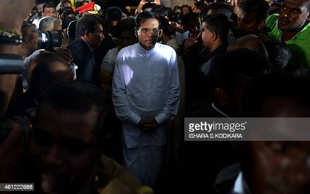 Sri Lanka's newlyelected president Maithripala Sirisena leaves after being sworn in at Independence Square in Colombo on January 9 2015 Maithripala...