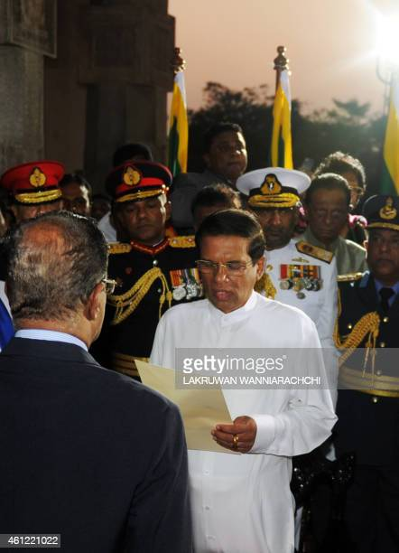 Sri Lanka's newlyelected president Maithripala Sirisena takes oath as he is sworn in at Independence Square in Colombo on January 9 2015 Maithripala...
