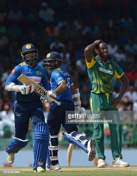 Sri Lanka's Niroshan Dickwella and teammate Upul Tharanga run between the wickets as South Africa's Kagiso Rabada look on during the fifth and final...