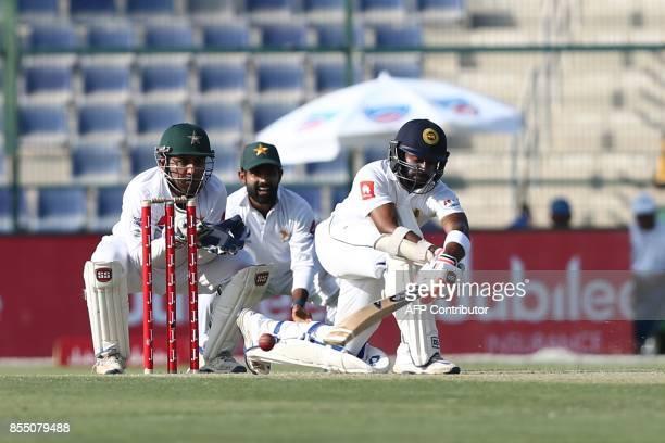 Sri Lanka's Niroshan Dickwella bats on the first day of the first Test cricket match between Pakistan and Sri Lanka at Sheikh Zayed Stadium in Abu...