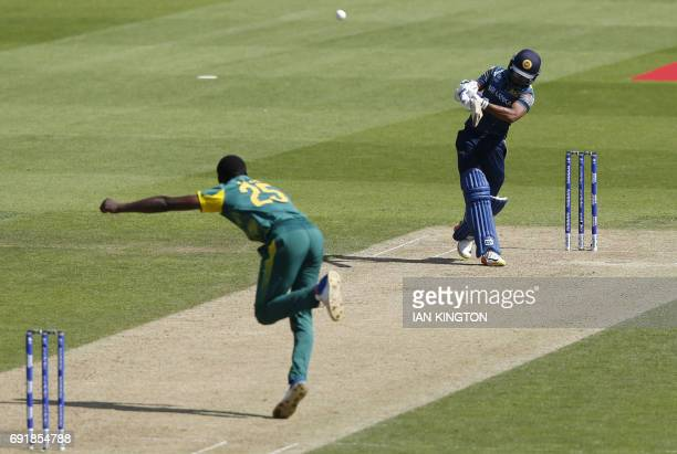 Sri Lankas Niroshan Dickwella hits a six off the bowling of South Africas Kagiso Rabada during the ICC Champions Trophy match between South Africa...