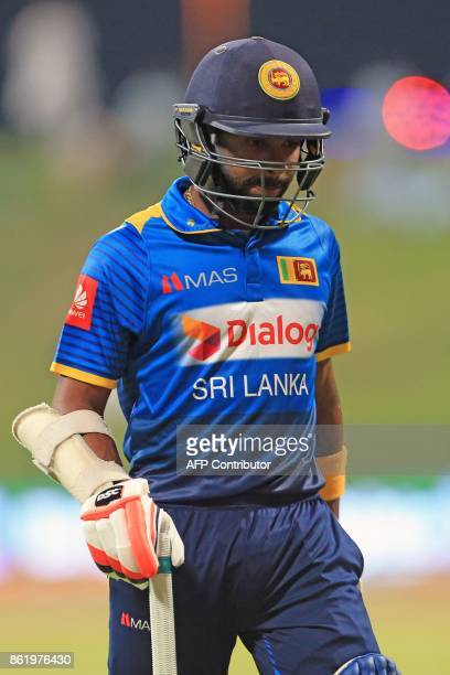 Sri Lanka's Niroshan Dickwella leaves the field after being dismissed by Pakistan's Junaid Khan during the second one day international cricket match...