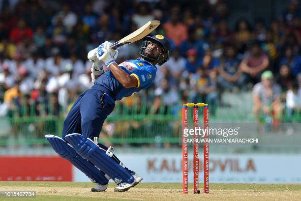 Sri Lanka's Niroshan Dickwella tries to avoid a bouncer of South Africa's Kagiso Rabada during the fifth and final one day international cricket...