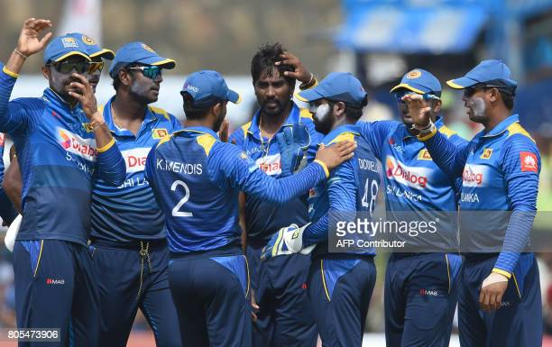 Sri Lanka's Nuwan Pradeep celebrates with his teammates after he dismissed Zimbabwe's Solomon Mire during the second oneday internationals cricket...