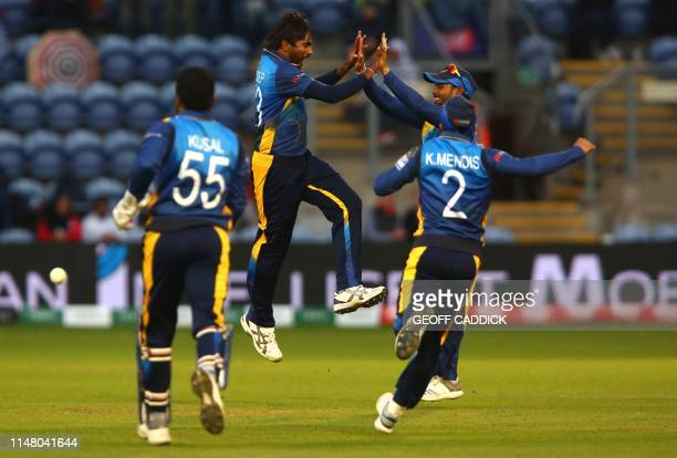Sri Lanka's Nuwan Pradeep celebrates with team mates after taking the wicket of Afghanistan's Rashid Khan for two runs during the 2019 Cricket World...