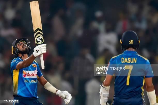 Sri Lanka's Oshada Fernando celebrates after socring 50 runs during the third and final Twenty20 International cricket match between Pakistan and Sri...