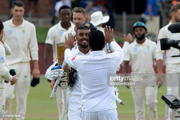 Sri Lanka's Oshada Fernando greets teammates after victory on the third day of the second Test cricket match between South Africa and Sri Lanka at St...