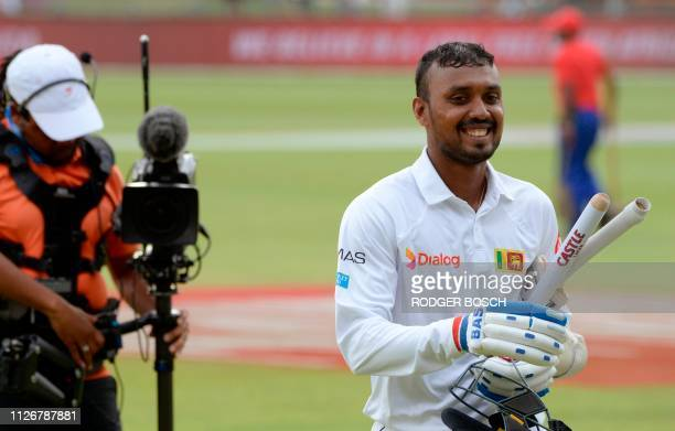 Sri Lanka's Oshada Fernando walks off the pitch after victory on the third day of the second Test cricket match between South Africa and Sri Lanka at...