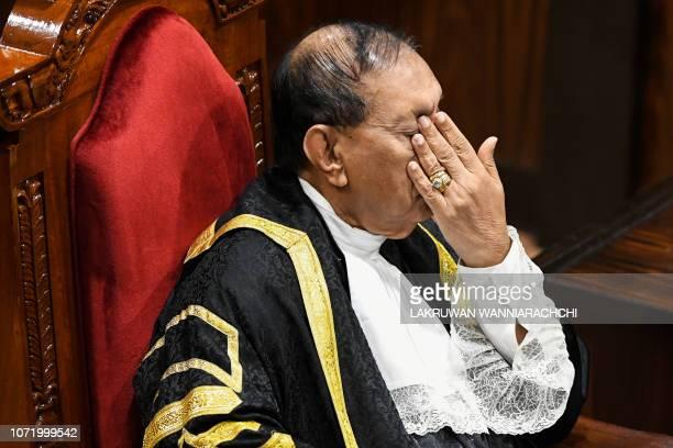 Sri Lanka's parliament speaker Karu Jayasuriya gestures during a parliament session in Colombo on December 12, 2018. - Sri Lanka's legislature voted...