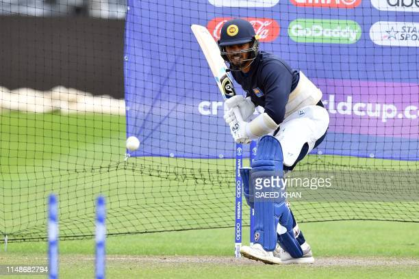 Sri Lanka's player Dhananjaya De Silva plays in the nets as he attends a training session at Bristol County Ground in Bristol southwest England on...