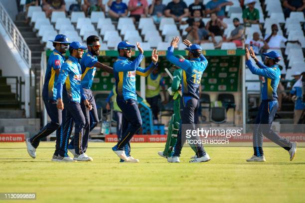 Sri Lanka's players celebrate after dismissing Quinton de Kock during the 5th One Day International cricket match between Sri Lanka and South Africa...