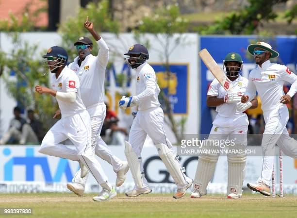 Sri Lanka's players celebrate after dismissing South Africa's Temba Bavuma during the third day of the opening Test match between Sri Lanka and South...