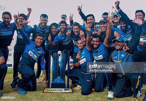 Sri Lanka's players celebrate after winning the final of the Blue Mountain Achilleion triseries played between Sri Lanka and hosts Zimbabwe at the...