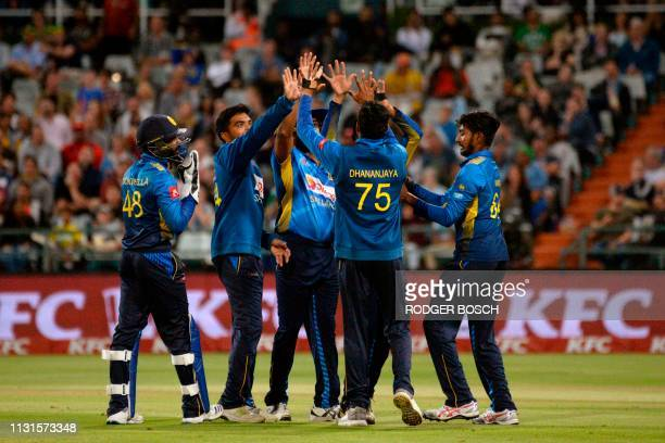 Sri Lanka's players celebrate taking the wicket of South Africa's Faf du Plessis during the first Twenty20 international cricket between South Africa...