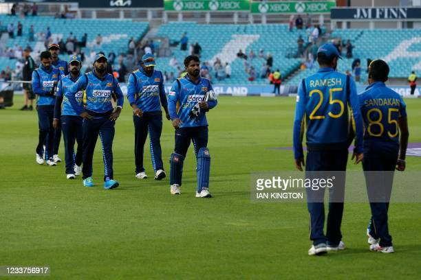Sri Lanka's players leave the field at close of play during the second one-day international between England and Sri Lanka at The Oval, south London...