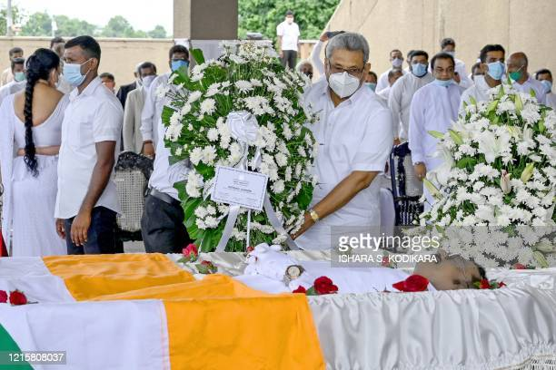 Sri Lanka's President Gotabhaya Rajapaksa presents a wreath to pay his respects during a laying in state ceremony for late tea plantation trade union...