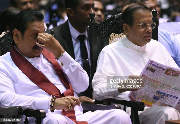 Sri Lankas President Maithripala Sirisena and former president and currently appointed Prime Minister Mahinda Rajapaksa attend a ceremony granting...