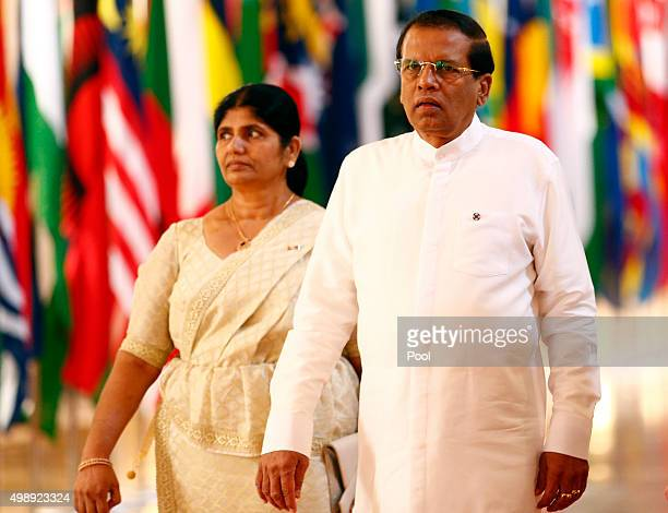 Sri Lanka's President Maithripala Sirisena and his wife Jayanthi arrive arrive for the opening ceremony of the Commonwealth Heads of Government...