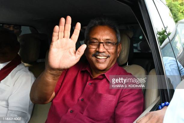 Sri Lanka's Presidentelect Gotabaya Rajapaksa waves at supporters as he leaves the election commission office in Colombo on November 17 2019 Gotabaya...