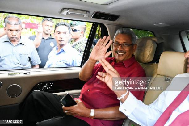 Sri Lanka's Presidentelect Gotabaya Rajapaksa waves from inside his car as he leaves his house to go to the election commission office in Colombo on...