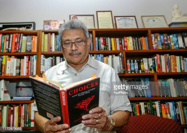 Sri Lanka's presidential candidate of Sri Lanka Podujana Peramuna and former defence secretary Gotabaya Rajapaksa reads a book at his residence in...