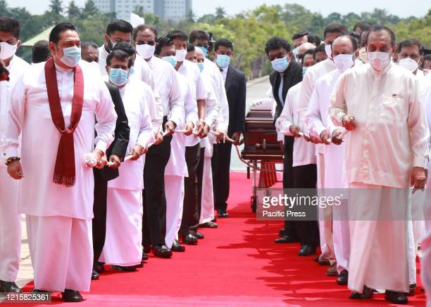 Sri Lanka's Prime Minister Mahinda Rajapaksa and former speaker of the Parliament Karu Jayasuriya attend the funeral of Ceylon Workers' Congress...