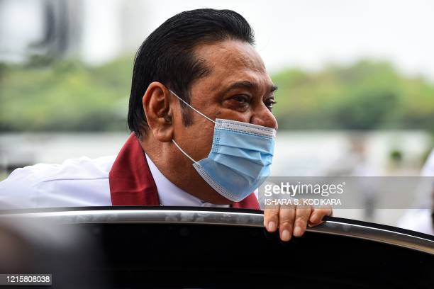 Sri Lanka's Prime Minister Mahinda Rajapaksa arrives to attend a laying in state ceremony for late tea plantation trade union leader and government...
