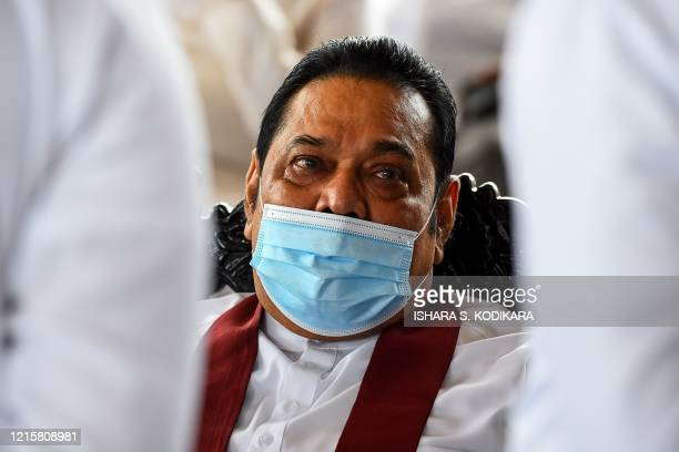 Sri Lanka's Prime Minister Mahinda Rajapaksa attends a laying in state ceremony for late tea plantation trade union leader and government minister...