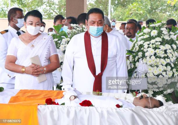 Sri Lanka's Prime Minister Mahinda Rajapaksa presents a wreath to pay his respects during the funeral of Ceylon Workers' Congress trade union leader...