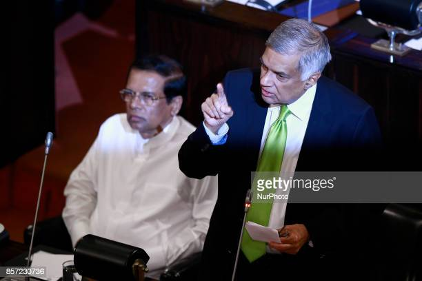 Sri Lanka's Prime Minister Ranil Wickremesinghe delivers a speech as President Maithripala Sirisena looks on during a special sitting of parliament...