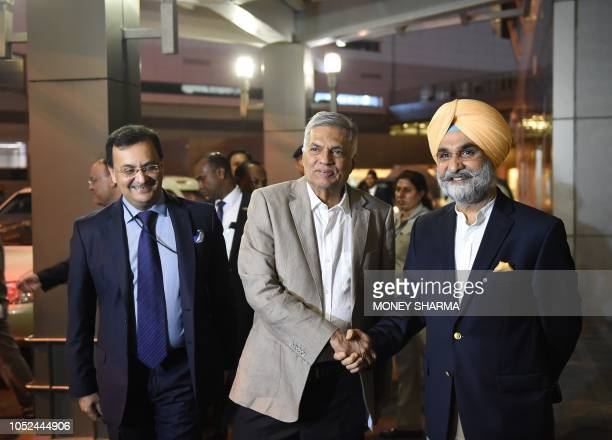 Sri Lanka's Prime Minister Ranil Wickremesinghe shakes hands with Taranjit Singh Sandhu High Commissioner of India to Sri Lanka during his arrival at...