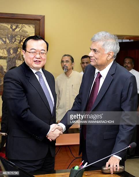 Sri Lankas Prime Minister Ranil Wickremesinghe shakes hands with the visiting Chinese special envoy Liu Jianchao in Colombo on February 6 2015 The...