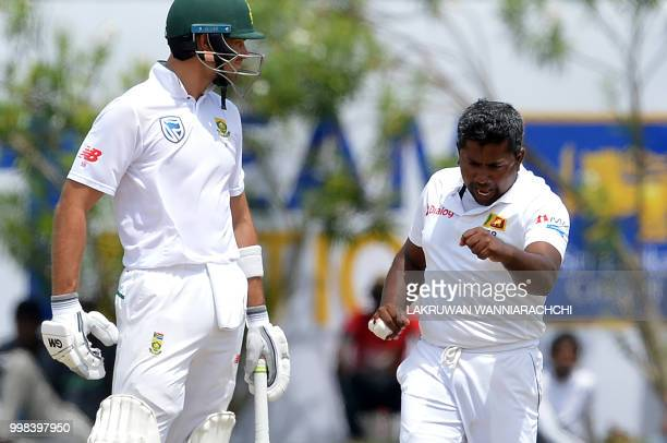 Sri Lanka's Rangana Herath celebrates after he dismissed South Africa's captain Faf du Plessis during the third day of the opening Test match between...