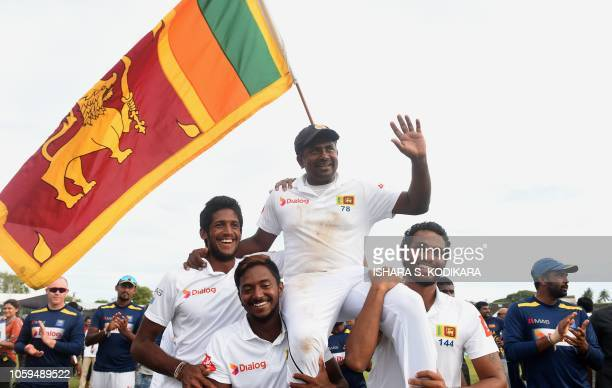 Sri Lanka's Rangana Herath is carried off the field by teammates as he waves to fans after England won the opening Test cricket match against Sri...