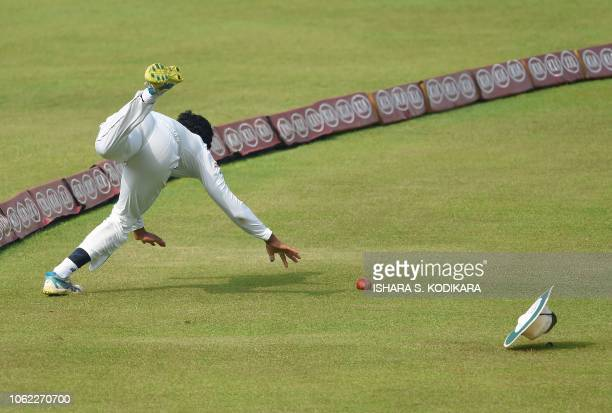 TOPSHOT Sri Lanka's Roshen Silva tries to stop the ball during the third day of the second Test match between Sri Lanka and England at the Pallekele...