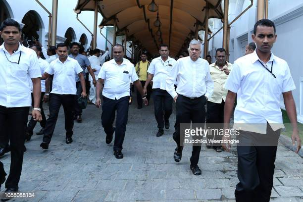 Sri Lanka's sacked prime minister Ranil Wickremesinghe walks with security at his official residence Temple Trees on November 6, 2018 in Colombo, Sri...