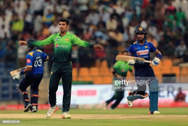 Sri Lanka's Samarawickrama runs between the wickets past Pakistan's Shadab Khan during the first T20 cricket match between Sri Lanka and Pakistan at...