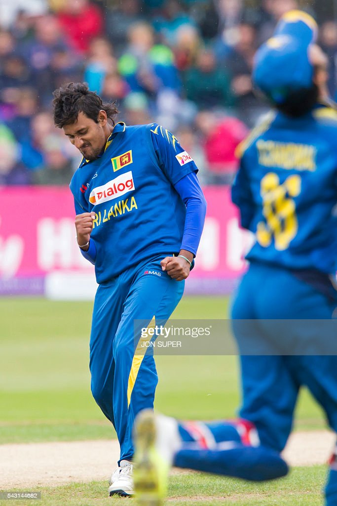 Sri Lanka's Suranga Lakmal (L) celebrates after taking the wicket of England's Alex Hales during play in the third one day international (ODI) cricket match between England and Sri Lanka at Bristol cricket ground in Bristol, south-west England, on June 26, 2016. Chris Woakes and Liam Plunkett both took three wickets apiece as England held Sri Lanka to 248 for nine in the third one-day international at Bristol on Sunday. / AFP / JON