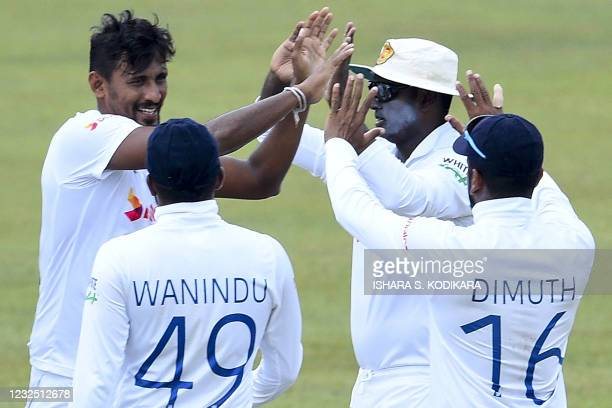 Sri Lanka's Suranga Lakmal celebrates with teammates after taking the wicket of Bangladesh's Saif Hassan during the fifth and final day of the first...