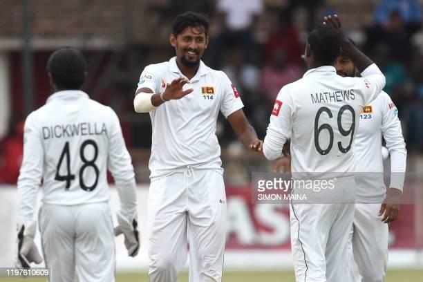 Sri Lanka's Suranga Lakmal celebrates with teammates after the dismissal of Zimbabwe's Tinotenda Mutombodzi during the fourth day of the second Test...