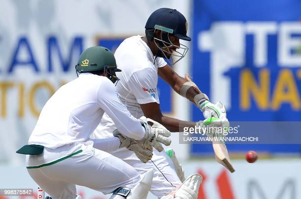 Sri Lanka's Suranga Lakmal plays a shot in front of South Africa's wicketkeeper Quinton de Kock during the third day of the opening Test match...