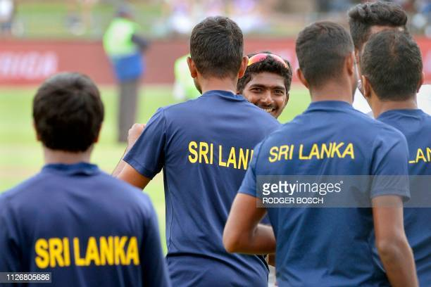 Sri Lanka's teammates celebrate after victory on the third day of the second Test cricket match between South Africa and Sri Lanka at St. George's...