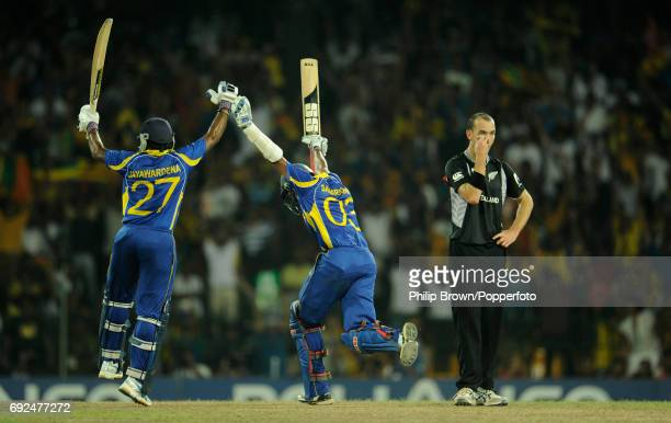 Sri Lanka's Thilan Samaraweera and Mahela Jayawardene celebrate their team's win next to New Zealand's Andy McKay following their ICC Cricket World...