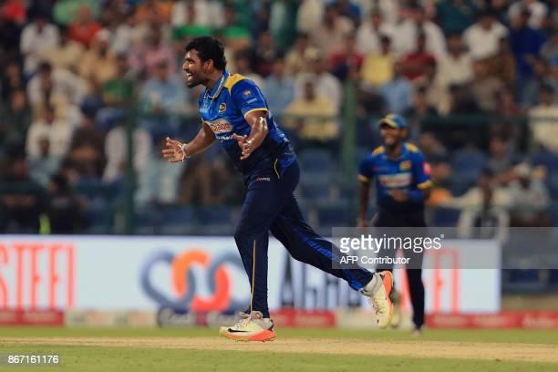 Sri Lanka's Thisara Perera celebrates taking the wicket of Pakistan's Ahmed Shehzad during the second Twenty20 series cricket match Pakistan vs Sri...
